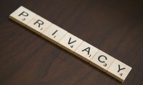 Scrabble pieces spell out the word Privacy.
